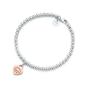 Tiffany & Co. Luxusní stříbrný náramek s pozlaceným srdíčkovým přívěskem 30929209 + originální balení 7
